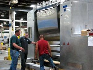Three Guys working on this machine